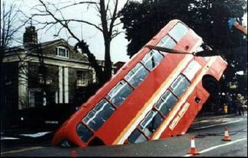 Bus in a hole - Funny Pictures and Images