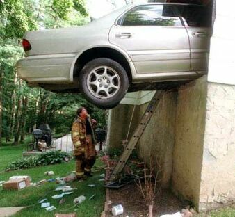 Car Crushed On A High Wall - Funny Pictures and Images