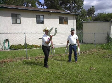 Tossing horseshoes - Funny Pictures and Images